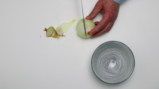 Chopping onion.