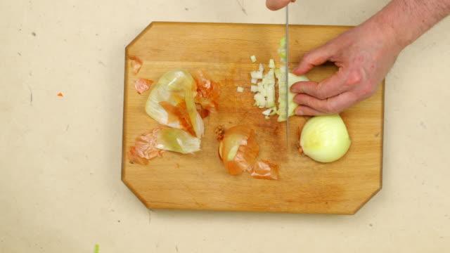 Chopping onion.