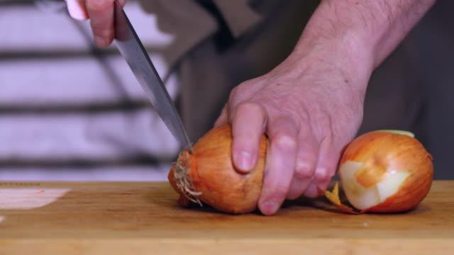 chopping onions. - annick vanderschelden stock videos & royalty-free footage