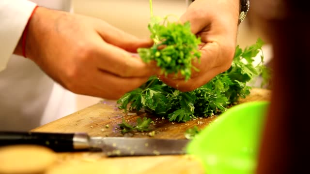 chopping parsley - cilantro stock videos and b-roll footage