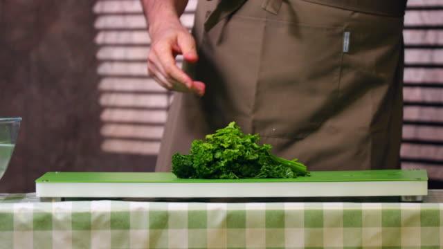 Chopping parsley.