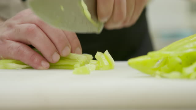chopping pepper in small cubes - raw food diet stock videos & royalty-free footage