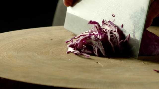 chopping purple cabbage - chopped stock videos & royalty-free footage