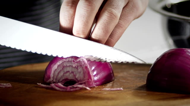 chopping red onion - red onion stock videos & royalty-free footage