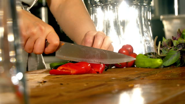 chopping red pepper - close up - chopping board stock videos & royalty-free footage