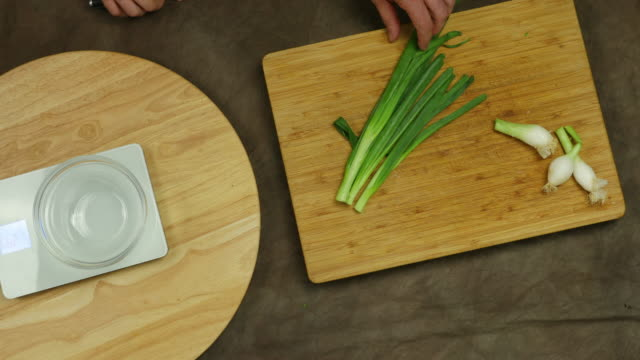 Chopping spring onion.