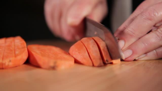 chopping sweet potato to cubes - sweet potato stock videos & royalty-free footage