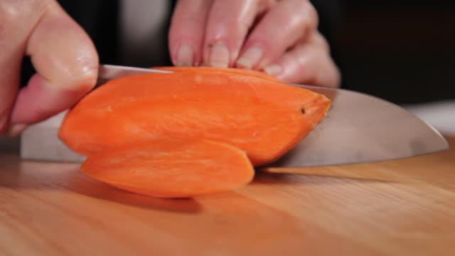 chopping sweet potato to strips - sweet potato stock videos & royalty-free footage