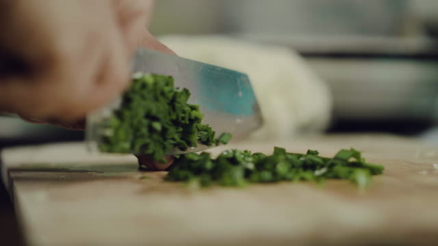 chopping vegetable in a kitchen. - sharp stock videos and b-roll footage