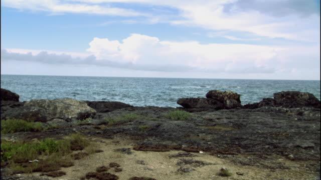 WS Choppy ocean waves flowing near rocky terrain / Columbus Cove, Jamaica
