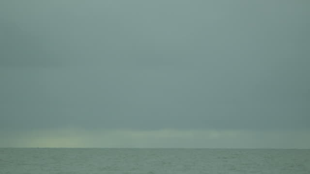 a choppy receding tide stretches out towards the horizon off the coast of essex, uk. - receding tide stock videos & royalty-free footage
