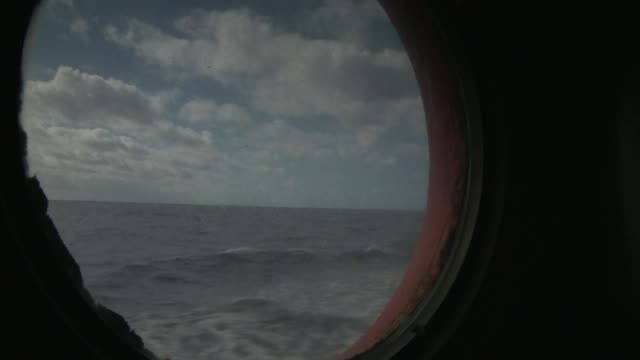 Choppy waters of the Southern Ocean seen through a porthole Available in HD.
