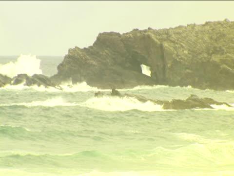 Choppy waves break against rocks Isle of Lewis