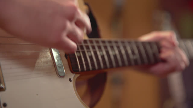 chords are played high up on the fretboard of an electric guitar - fretboard stock videos & royalty-free footage