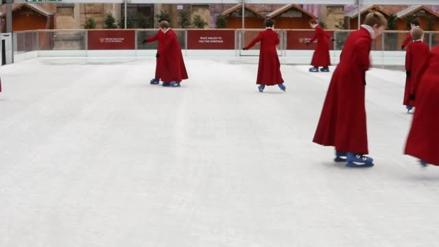 Choristers from the Winchester Cathedral Choir skate on the cathedral's ice rink which will be open until the 7th January 2018