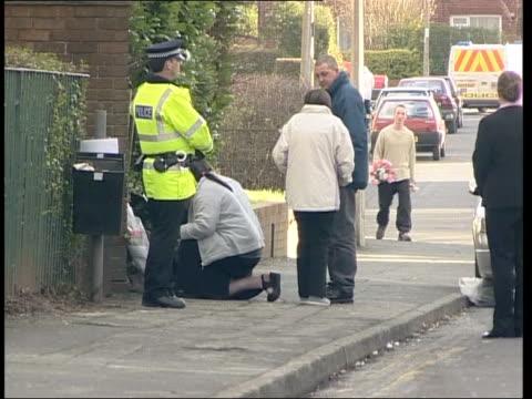 chorley mother stabbed in alley; 22.16: emma murphy england: lancashire: chorley: ext family of melanie horridge visiting scene of murder - itv weekend late news点の映像素材/bロール