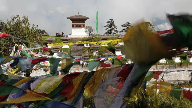 chortens or stupas  built at the head of the dochula pass, thimphu, bhutan, asia - thimphu stock videos & royalty-free footage
