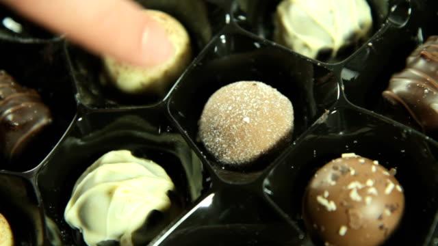 Chosing a Chocolate. HD