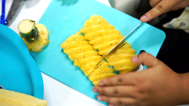 chpped pineapple in plastic plate and slice of pineapple fruit - pineapple stock videos & royalty-free footage