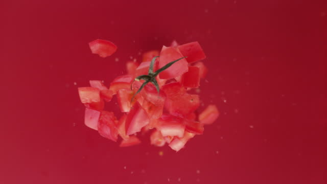 chpped tomato fruit. studio beauty shot. - chopped stock videos & royalty-free footage