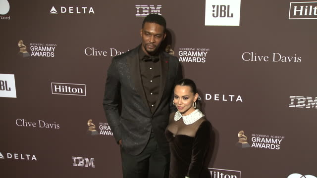 Chris Bosh and Adrienne Bosh at the Clive Davis' and the Recording Academy's PreGRAMMY Gala at The Beverly Hilton Hotel on February 09 2019 in...