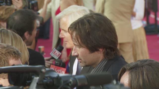 chris carter, david duchovny at the 'the x-files: i want to believe' premiere at los angeles ca. - xファイル点の映像素材/bロール