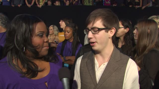 Chris Colfer Amber Riley and Kevin McHale on being at the People's Choice Awards on being nominated for an award for Glee on how their lives have...