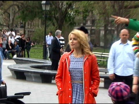 Chris Colfer and Dianna Agron wait on set while shooting the season finale of 'Glee' in Washington Square Park in Greenwich Village in New York...