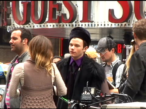 Chris Colfer waits for shooting to begin while filming the season finale of 'Glee' in Times Square in New York 04/28/11