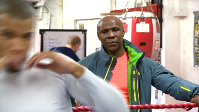 chris eubank junior prepares to fight billy joe saunders; date unknown: location unknown: eubank junior shadow boxing boxing to camera in ring eubank... - chris eubank sr. stock videos & royalty-free footage