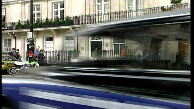 belgravia home; itn england: london: belgravia: ext gvs press assembled outside chris evans' belgravia home / gv front door tilt up / unused /... - in front of点の映像素材/bロール