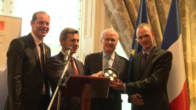vídeos de stock, filmes e b-roll de chris froome the winner of the 2013 tour de france attended the french embassy in london on monday to be awarded four silver coins made by la monnaie... - marcação esporte