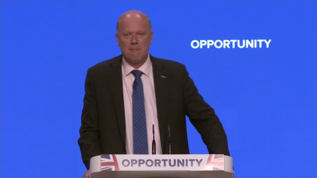 Chris Grayling announces oneclick rail travel compensation scheme ENGLAND Birmingham INT Wide shot conference hall Chris Grayling MP speech SOT