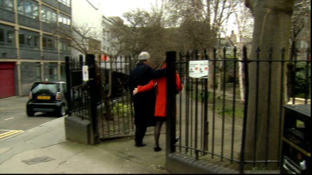 chris huhne and vicky pryce both jailed for 8 months for perverting the course of justice date unknown chris huhne along road with his arm around... - ビッキー・プライス点の映像素材/bロール