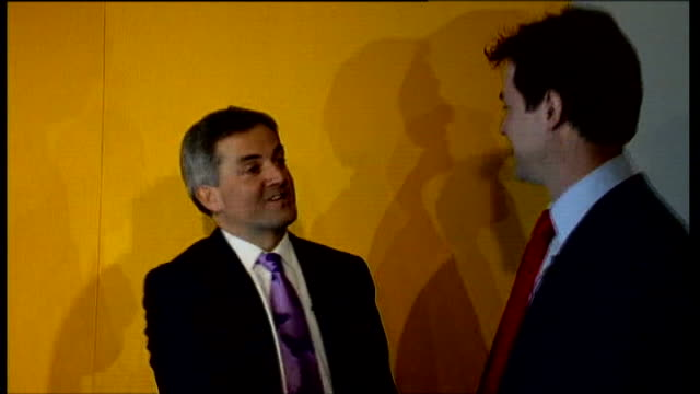 chris huhne and vicky pryce freed from prison lib int huhne shakes hands with nick clegg mp - ビッキー・プライス点の映像素材/bロール