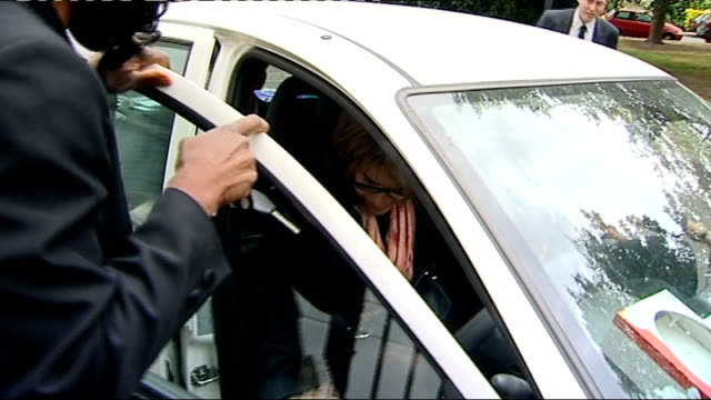 chris huhne denies he dodged penalty points for speeding vicky pryce getting in car as surrounded by press - ビッキー・プライス点の映像素材/bロール