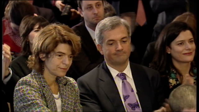 chris huhne resigns from cabinet to face charges of perverting the course of justice; date unknown location unknown: huhne and pryce sitting in... - クリス ヒューン点の映像素材/bロール