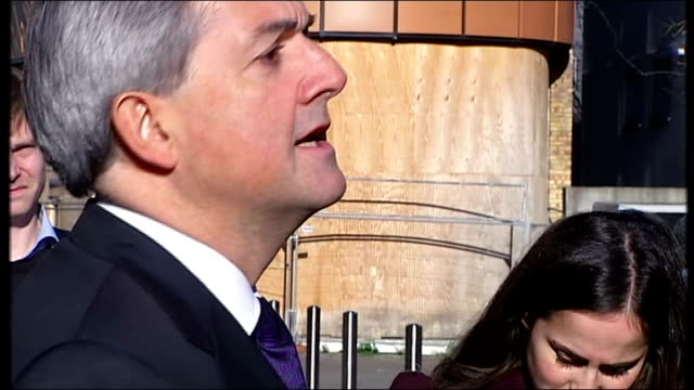 chris huhne resigns from cabinet to face charges of perverting the course of justice; england: london: ext chris huhne mp leaving building then... - クリス ヒューン点の映像素材/bロール