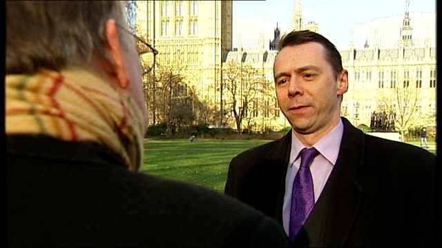 chris huhne resigns from cabinet to face charges of perverting the course of justice; ext mark littlewood interview sot - クリス ヒューン点の映像素材/bロール