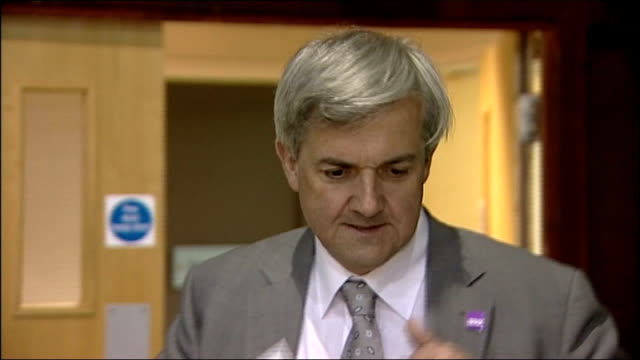 chris huhne resigns from cabinet to face charges of perverting the course of justice 652011 eastleigh int close shot huhne trimingham and huhne at... - hampshire stock-videos und b-roll-filmmaterial