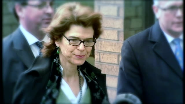 jury hears that wife sought revenge various shots of vicky pryce posing for pressl outside court - ビッキー・プライス点の映像素材/bロール