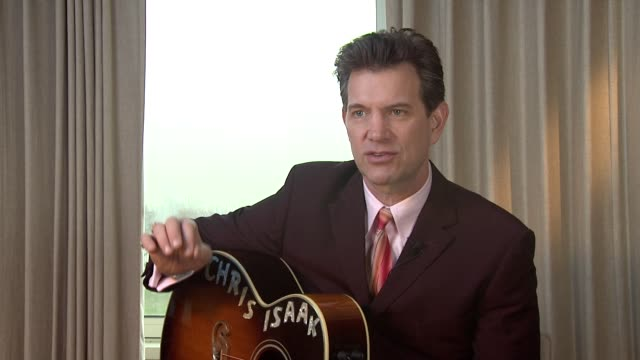 vídeos de stock, filmes e b-roll de chris isaak on his drawing style and how they appeal to different audiences at chris isaak interview the royal garden hotel on 24th january 2012 in... - chris isaak