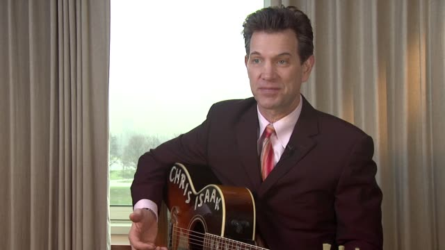 vídeos de stock, filmes e b-roll de chris isaak on the experience of recording at sun studios and its legacy with elvis at chris isaak interview the royal garden hotel on 24th january... - chris isaak