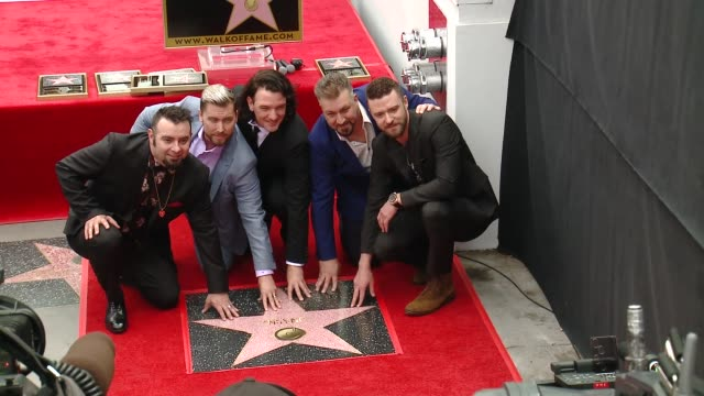 chris kirkpatrick, lance bass, jc chasez, joey fatone, justin timberlake at the *nsync honored with a star on the hollywood walk of fame on april 30,... - walk of fame stock videos & royalty-free footage
