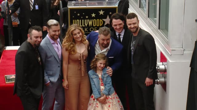nsync chris kirkpatrick lance bass jc chasez joey fatone justin timberlake at the *nsync honored with a star on the hollywood walk of fame on april... - イン・シンク点の映像素材/bロール