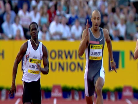 chris lambert and christian malcolm go head to head in men's 200m won by lambert 2004 crystal palace athletics grand prix london - dynamics stock videos and b-roll footage