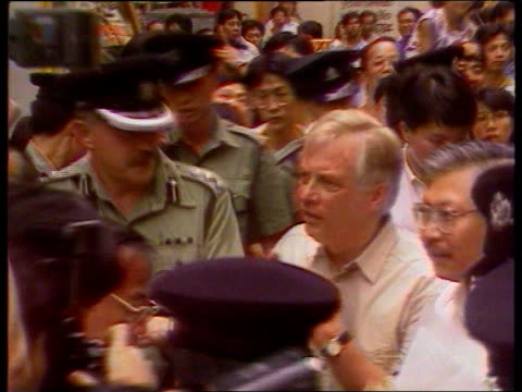 chris patten health tms patten escorted by soldiers through mass crowds r ms more ditto towards bureau - kommode stock-videos und b-roll-filmmaterial