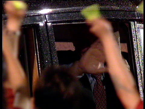 chris patten in car leaving parade-ground through crowd of waving children at end of farewell ceremony hong kong handover; 30 jun 97 - 1997 stock videos & royalty-free footage