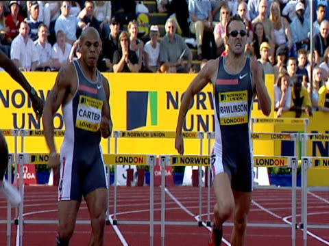 Chris Rawlinson and James Carter go head to head Rawlinson wins close finish and hugs Carter Men's 400m Hurdles 2004 Crystal Palace Athletics Grand...