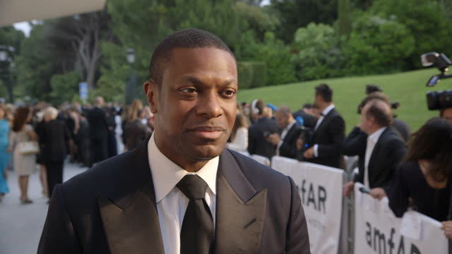 INTERVIEW Chris Tucker on being at AmfAR at AmfAR Red Carpet at Hotel du CapEdenRoc on May 22 2014 in Cap d'Antibes France
